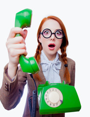teacher with round glasses and green dial telephone