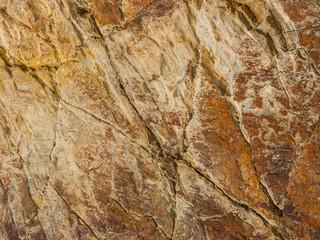 Natural cut stone. Colorful natural stone texture. Stone texture background. Detailing the texture of the stone.