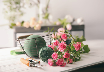 Florist equipment with flowers on table