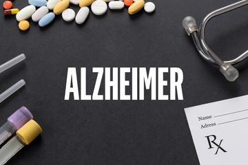 ALZHEIMER written on black background with medication