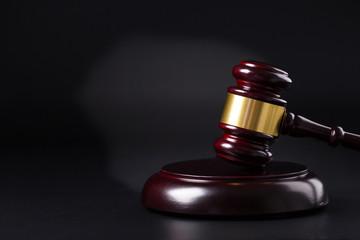 Wooden judge gavel isolated on black background