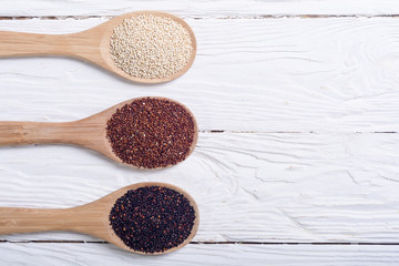 Black , white and red quinoa in spoon