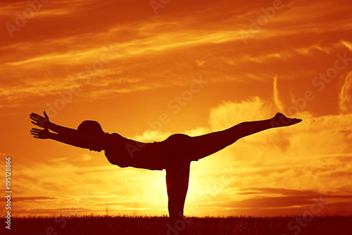 Silhouette Of A Young Girl Yoga Pose Sunset Sport