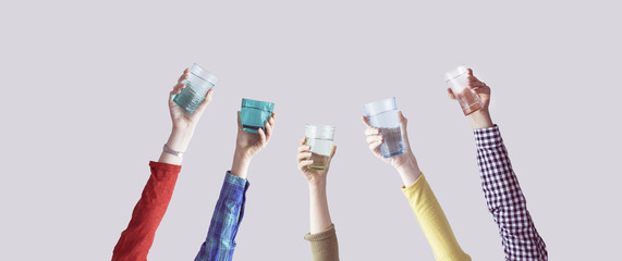 Different people holding water glass