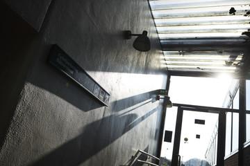 Empty corridor with a concrete wall