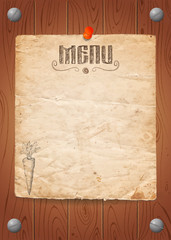 Menu of restaurant with carrot on old paper and wooden background