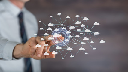 Man touching a cloud network on a touch screen