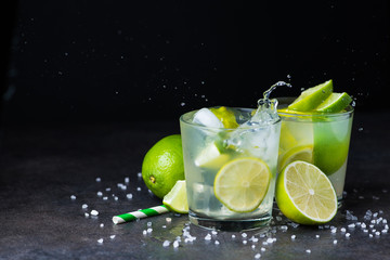 fresh summer caipirinha cocktail with splash