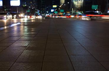 Night Shot of Seoul Street with Cars Passing. Blur Bokeh. Sejong Daero. Gwanghwamun.