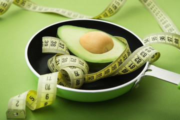 Yellow measuring tape with avocado