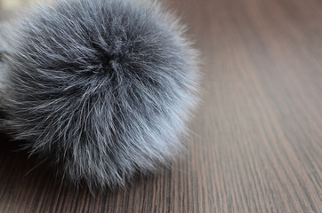 Pompom on a wooden background