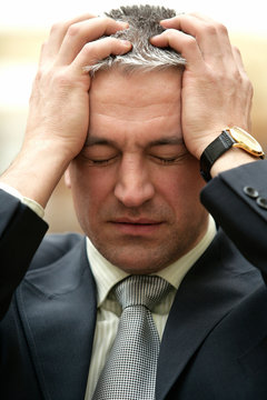 Mature frustrated worrying businessman have a problem