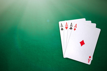Four aces on casino table