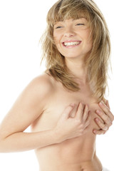 Topless young blonde laughing shy woman covering her breast with hands