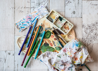 Artist equipment - Watercolors, paintbrushes, color palette and pastels
