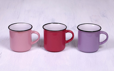 three tea cups on white wood table background