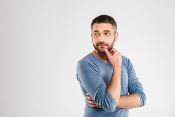 Thoughtful man isolated over white background