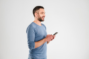 Happy man chatting by mobile phone.