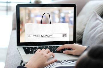 Woman hands typing laptop computer with cyber monday sale on search bar banner background, Online shopping, business and technology