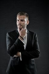 Director in formal jacket, shirt on dark background, fashion
