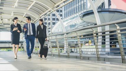 business people walk outdoor pedestrian walkway