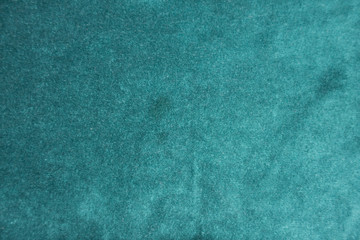 Surface of dark green napped fabric from above