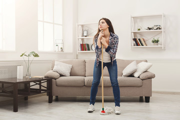 Young woman tired of spring cleaning house