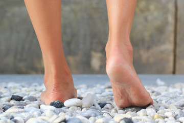 Close up of women walk on a rock, Relaxation and massage, Healthcare and spa stones concept
