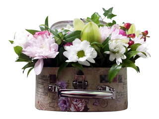 Bouquet of flowers in a suitcase. Arrangement of flowers from roses, chrysanthemums and orchids