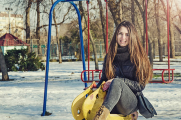 A girl is having some fun in the park