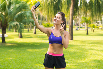 Woman taking selfie during her workout