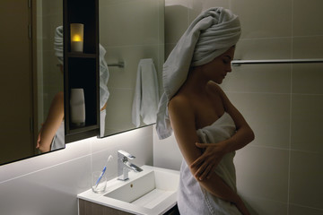 Beautiful woman wrapped in the towel after shower