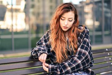 Beautiful girl sitting outdoors