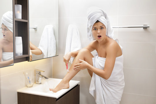 Woman is shaving her legs