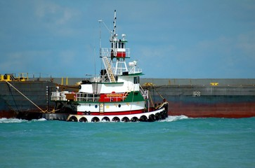 Tug Boat towing a barge
