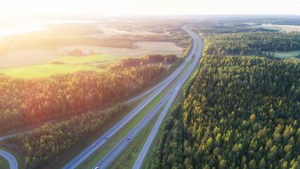 Foto auf Acrylglas Khaki Highway at the sunset. Finland