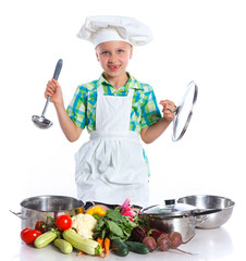 Little Girl Chef cook with fresh vegetables