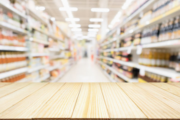 Abstract blur supermarket discount store aisle and product shelves interior defocused background