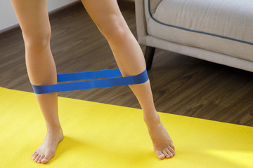 Fitness workout at home with rubber resistance band