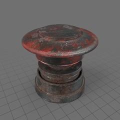 Wide, rusty push button