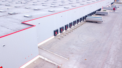 Aerial view on loading bays in distribution center. Aerial Wall mural