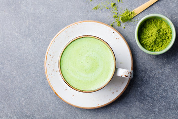 Matcha green tea latte in a cup. Top view.