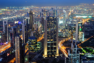 Aerial night view of skyscrapers of Dubai World Trade center