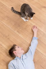 teenager boy with cat
