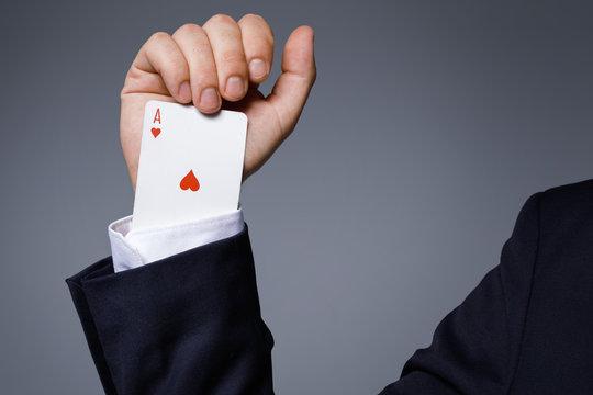 Man is hiding an Ace in the sleeve
