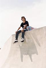 Man with skateboard on ramp