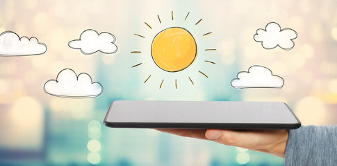 Sunny Day with man holding a tablet computer