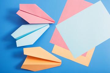 paper plane on blue color background