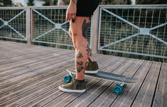 tattoed woman with her skate
