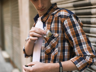 Man putting dope pack to pocket